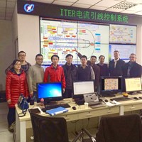 From left to right, the test team and witnesses—Du Qing (ASIPP); Wu Song (ITER China); Seungje Lee (ITER Organization); Ding Kaizhong (ASIPP); Lu Kun (ASIPP's feeder team leader); Niu Erwu (ITER China); Yifeng Yang, Wu Songtao, Arend Nijhuis, and Arnaud Devred (Superconductor & Auxiliaries Section leader) from ITER—stand in the ASIPP test hall control room, in front of the MIMIC screen generated by the ITER control system. (Click to view larger version...)