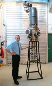 John Jelonnek, who is in charge of the KIT development program for the gyrotron, stands next to the 1 MW short-pulse prototype. (Click to view larger version...)