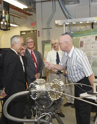 Director-General Motojima was the operator during a pellet injection laboratory test. Also in the picture: US ITER Project Manager Ned Sauthoff; ITER Deputy Director-General Gary Johnson; and ORNL researchers Stephen Combs and Larry Baylor. (Click to view larger version...)