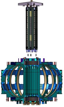 The assembled central solenoid hanging over the tokamak for installation. (Click to view larger version...)
