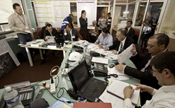 The objective was to test not only CEA-Cadarache's response to a major earthquake, but also to analyze the decision-making process between the different parties involved. Here the ''War Room,'' where actions were coordinated. (CEA-Cadarache Director Maurice Mazière is 4th from right.) (Click to view larger version...)