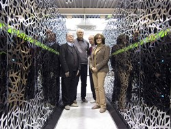 The CEA-F4E CSC team standing between a section of the Helios supercomputer, from left to right: Jacques David, François Robin, Jacques Noé (CEA) and Susana Clement Lorenzo (F4E). (Click to view larger version...)