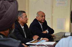Srikumar Banerjee, the chairman of the Indian Atomic Energy Commission (right), and ITER Deputy Director-General Dhiraj Bora, talking to Indian staff members. (Click to view larger version...)