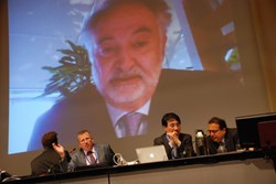 The head of ITER Communication Michel Claessens (2nd from left), chairs a session with Jacques Attali, who came in via video. (Click to view larger version...)