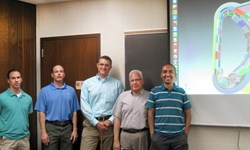 Standing in front of a neutronics model of ITER: (left to right) Ed Marriott, Tim Bohm, Paul Wilson, Mohamed Sawan and Ahmad Ibrahim, US ITER researchers at the University of Wisconsin. (Click to view larger version...)