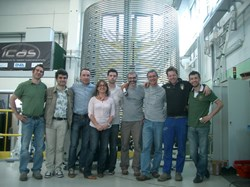 The ICAS and European Domestic Agency teams in front of the first toroidal field conductor production length. (Click to view larger version...)