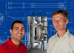 Dr. Olaf Neubauer (right) and David Castaño Bardawil (left) in front of a cross-section model of the ITER fusion reactor. Source: Forschungszentrum Jülich (Click to view larger version...)