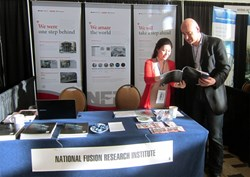 At the stand of the Korean National Fusion Research Institute, a promise to ''amaze the world.'' (Click to view larger version...)