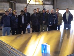 A perfectly polished ITER drain tank steel plate at Stainless Steel Services (USA) with a surface finish well below 1.6 micrometres. Alongside Giovanni Dell Orco, Thierry Jourdan and Babulal Gopalapillai from ITER are members of US-ITER, AREVA FS, Joseph Oats Corporation and Stainless Steel Services. (Click to view larger version...)