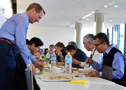 The Director of the European Domestic Agency, Henrik Bindslev (left), takes a seat facing DG Motojima and ITER India's Indranil Bandyopadhyay for a quick sandwich at the ITER cafeteria. (Click to view larger version...)