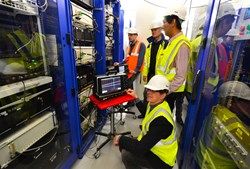 The core of the infrastructure is located in a technical room in the basement of ITER Headquarters. The software undergoes rigorous testing before release. Left to right: Xavier Mocquard, Anders Wallander, Changseung Kim and Petri Mäkijärvi. (Click to view larger version...)