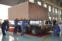 Workers at ASIPP are busy preparing to load the 737 metres of dummy conductor for ITER's Poloidal Field Coil number five. (Click to view larger version...)