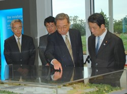 Inside the Visitors' Centre, from left to right: Daini Tsukahara, Consul General of Japan in Marseille; Eisuke Tada, head of ITER Central Integration and Engineering; DG Ikeda and Minister Kawabata. (Click to view larger version...)