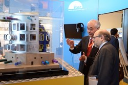 ITER Director-General Motojima introduces Pere Torres, the representative of the Catalonian government, to the ITER machine. (Click to view larger version...)