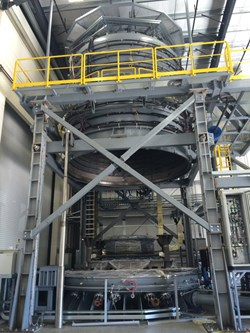 The reaction heat treatment furnace is shown opened up; the upper portion will descend when a module is inside. Photo: US ITER (Click to view larger version...)