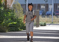 A determined youngster heading for his first day in class. (Click to view larger version...)