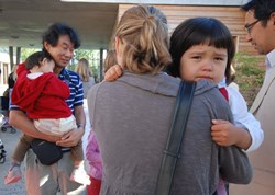 Weeping and holding on tight to Mummy are part of ''back-to-school'' days everywhere in the world. (Click to view larger version...)