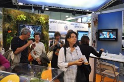Many a visitor stood captivated by the 3D animations, video clips and panels featured on the ITER stand. (Click to view larger version...)