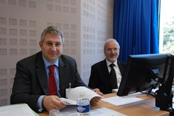 Werner Burkart, IAEA Deputy Director-General, and Ralf Kaiser, Head of the Agency's Physics Section, observing the proceedings at the seventh ITER Council meeting. (Click to view larger version...)