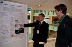 Monaco Postdoctoral Fellow Evgeny Veshchev during the poster session, explaining his research. (Click to view larger version...)