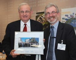 After seven years acting as Chairman of the ITPA, Ron Stambaugh from the US stepped down. On behalf of the panel's members, David Campbell from the ITER Directorate for Plasma Operations handed him a photo of the ''family.'' (Click to view larger version...)