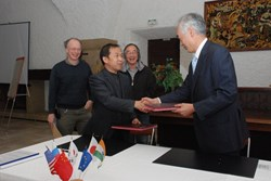 ITER Director-General Osamu Motojima and the Head of the Chinese Domestic Agency, Luo Delong, after the signature. Participating in the ceremony were Chen-yu Gung, Neil Mitchell and Gary Johnson. (Click to view larger version...)