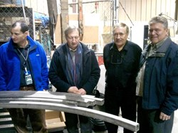 In front of the central solenoid conductor jacket bending trials, from left to right: Chris Rey (US-DA), Paul Libeyre (ITER), Charles Lyraud (ITER) and Wayne Reiersen (US-DA). (Click to view larger version...)