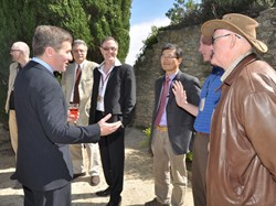 Charles H. Rivkin, US Ambassador to France, met with the ITER ''American Community'' and guests on the Château terrace. From left to right: Cesar Luongo; the Ambassador; Joe Minervini from MIT; Joe Snipes; Chang Jun Hoon; Ed Daly; and, wearing a hat, Bob Simmons visiting from the Princeton Plasma Physics Laboratory. (Click to view larger version...)
