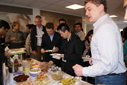 Hot curry and chai instead of coffee and croissant: guests at the 4th Intercultural Breakfast this week. (Click to view larger version...)