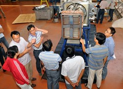 ITER personnel from China gather around the ITER-like antenna as it is beinng packed before shipment to Hefei via Shanghai. (Click to view larger version...)
