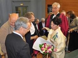 ''I cannot let this moment pass,'' said Prof. Motojima, ''without thanking my dear wife Kaoru who has been always at my side with constant support and encouragement.'' Mrs Motojima, in traditional kimono, is seen here in conversation with Japanese Consul General Danai Tsukhara. (Click to view larger version...)