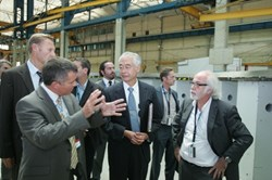 ITER Director-General Osamu Motojima (with Alessandro Bonito-Oliva to his right) inspecting the prototype at CNIM in Toulon. (Click to view larger version...)