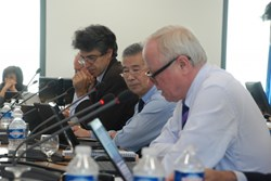 STAC Vice-Chair Joaquin Sanchez and STAC Chair Yuanxi Wan listening to ITER DDG Rem Haange's report. (Click to view larger version...)