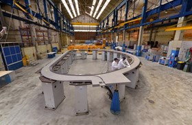 A radial plate (here at CNIM before packing and loading operations began) is a ten-ton, 8.5 x 15 metre, D-shaped stainless steel structure with grooves machined on both sides, into which insulated superconductor cable is inserted. (Click to view larger version...)