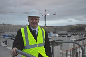 Taking a look at the big hole that will hold the machine: Alexander Alekseev, the new head of the Directorate for Tokamak. (Click to view larger version...)