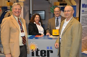 Holding up the ITER flag: Ned Sauthoff, Jamie Payne, Brad Nelson and Carl Strawbridge in front of the ITER stand at this year's AAAS conference. (Click to view larger version...)