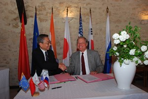 Ikeda san and Ned Sauthoff, Head of the US Project Office, signing the procurement for the electron cyclotron transmission line. (Click to view larger version...)