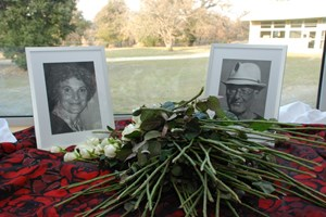 White roses were placed in front of the Tanga's photos. (Click to view larger version...)