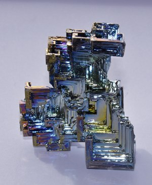 Semi-metallic bismuth crystal, used in thermoelectric compounds and special bearing alloys. © ESA (Click to view larger version...)