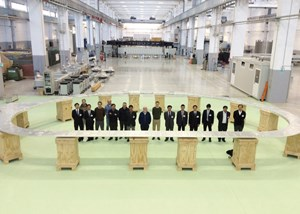 Representatives of the European and Japanese Domestic Agencies, Japanese manufacturers Toshiba and Mitsubishi, and the ASG consortium (ASG, Iberdrola and Elytt) pose inside of the completed, and successfully tested, prototype. (Click to view larger version...)