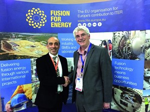Carlo Damiani, European Domestic Agency project manager for ITER remote handling systems shakes hands with Ian Grayson, Operations Director at AMEC Foster Wheeler. (Click to view larger version...)