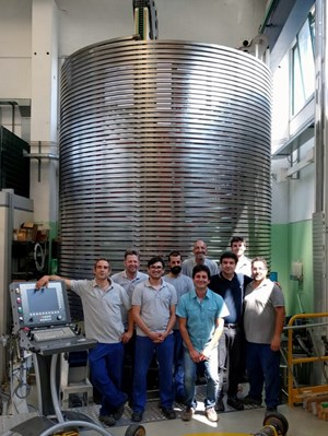 ICAS representatives stand in front of the last spool of poloidal field conductor. The material—some seven kilometres in all—will now be tested before shipment to China, where the sixth poloidal field magnet (PF6) will be manufactured. (Click to view larger version...)