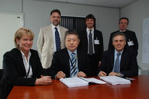 Standard procedure for a non-standard endeavour: (1. row f. left) Francoise Flament, Head of ITER Contract & Procurement Division, Deputy Director-General Yong-Hwan Kim and CESI Director Domenico Villani; Ivone Benfatto, head of the ITER Electrical Engineering Division; CESI Marketing Manager Andrea Meola; and Marino Valisi. (Click to view larger version...)