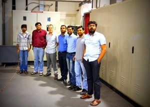 The team in front of the power cubicles at the dedicated lab in Gandhinagar: Dishang Upadhyay, Rasesh Dave, Thibault Gassmann, Amit Patel, Hitesh Dhola, Niranjan Goswami and Kush Mehta. (Click to view larger version...)