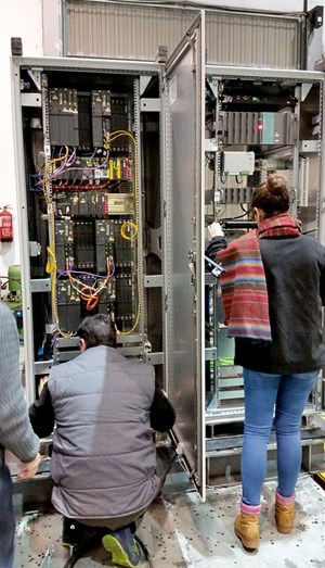 The electronic components had been aged in previous tests to simulate a situation in which the seismic event occurs near or at the end of ITER's lifetime. In this photo, experts carry out visual inspections. (Click to view larger version...)