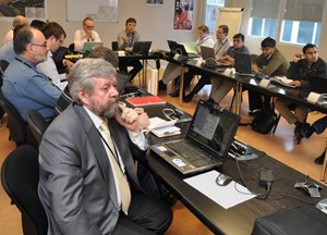 The SQAWG working group usually meets four times a year, twice by videoconference and twice in person. Sitting up front is Pavel Chaïka, from the Russian DA. (Click to view larger version...)
