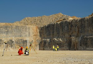 In a scene reminiscent of an Apollo Moon mission, geologists take measurements in the Tokamak Excavation pit. (Click to view larger version...)