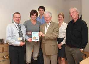 Mike Forrest handing over a copy of his book to the ITER Newsline team. (Click to view larger version...)