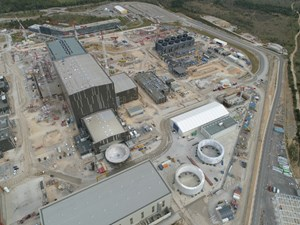 From the air, three of the cryostat sections are visible—two cylinders cocooned and stored at right, and the cryostat base as it enters the Cleaning Facility/Assembly Hall. Photo: ITER Organization/EJF Riche (April 2020) (Click to view larger version...)