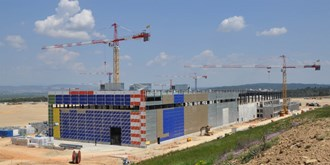 The united colours of ITER will eventually merge into champagne and orange. (Click to view larger version...)